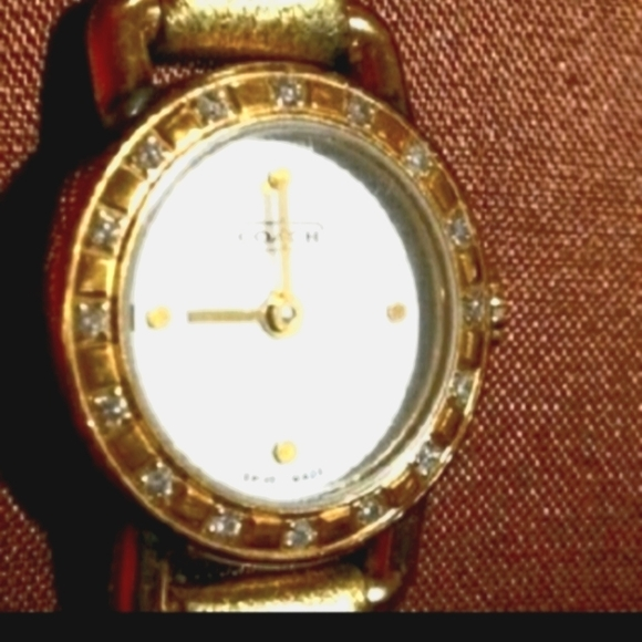 Coach watch has Mother of Pearl face with real dia
